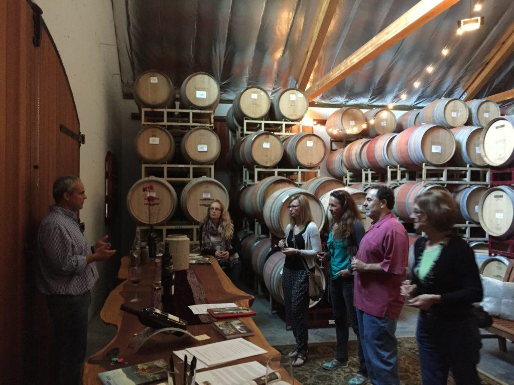 Gus Gamba Tasting Visitors in the Barrel Room